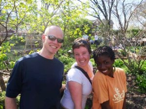 Sally (middle) with her husband Nic and friend Latasha at SEEDS in Durham, North Carolina (the community garden they used to volunteer at).